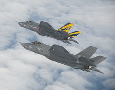 Two jets are on a formation test flight in the Atlantic test range. by Official U.S. Navy Imagery, via Flickr