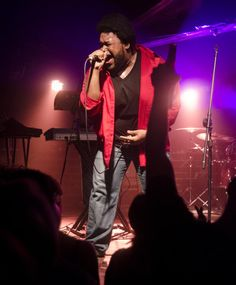 The Main Squeeze frontman Corey Frye leans toward audience members as he sings impassionedly on Jan. 12 at The Bluebird Nightclub. The band, which started in Bloomington, Ind., recently relocated to Chicago.  | Indiana Daily Student