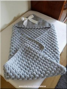Beautiful hooded baby blanket, the english pattern is on Lion Brand website…