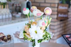 secret garden theme party wood wedding flowers flower arrangement sweet treats cake pops birds decoration