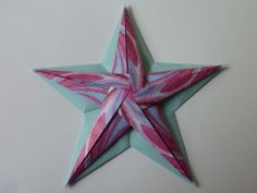 Stern aus zweierlei Papier. Modell von Tomoko Fuse. Anleitung aus der Landlust November/Dezember 2013.