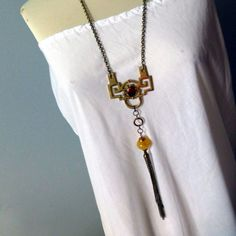 Silk Road Long Tassel Necklace will make a delightful gift for her ! Made with vintage frame hanger and bead.