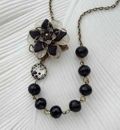 Black and Soft Peach Asymmetrical Flower Statement Necklace in Antique Brass.