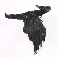 """Artist: Yong Ho Ji.  Work: """"Bull"""" .  Made with Recycled Tires"""