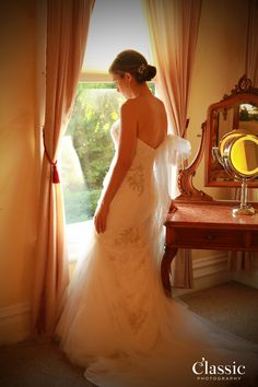 Emily having a quiet moment right before her wedding ceremony at Churchill Manor.  Classic Photography.