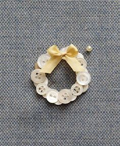 (::)  Little pearly button wreath to use as a boutonniere, brooch, package adornment, or ornament