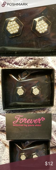 "Avon, Paula Abdul Art Deco Style Earrings These Avon earrings are from the ""Forever"" ""Selected By Paula Abdul"" line.  They're art Deco Style studs.  Black hexagon shaped earrings with a gold center covered in crystals.  Elegant and versatile!  Dress them up with your favorite little black dress or dress them down with a tunic and leggings! Avon Jewelry Earrings"