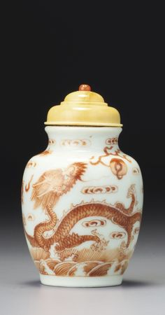 AN IRON-RED PORCELAIN 'DOUBLE DRAGON' SNUFF POT<br>SEAL MARK AND PERIOD OF DAOGUANG | lot | Sotheby's