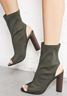 Olive Axis Cut-Out Booties are gunna change tha direction of the earth, bb. These supa chic ankle booties feature a sleek pull-on style, stretchy olive construction, peep toe, heel cut out, and tall block heel.