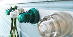 Insulator coat rack! Every time I go into an antique store and see these old glass insulators I swoon! I've just never really though about what I would do with them.  I love this idea though. Especially considering my husband is a lineman!!!