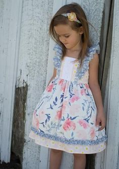 """Cheeky Plum Blooming Brook Dress Features: Fixed Straps Elastic back for a grow with me style Eyelet lace on bodice Fits true to size Ava is 42"""" 42lbs wearing a 4T. Would need 5T to last through Summer Made in USA"""