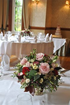 Silver stand with natural floral arrangement - Nunsmere Hall - by Laurel Weddings