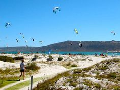 Kite surfers on Langebaan lagoon, West Coast. Surfers, Kite, Fossils, West Coast, Tours, Mountains, Beach, Nature, Fun