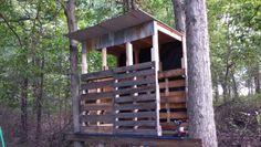 Deer blind made using old pallets and repurposed barn metal.