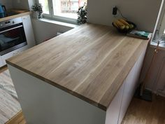 Working surface for kitchen island; made of oak.