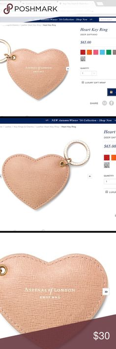 """❤️ Aspinal of London Key Ring Heart key ring in Deer Saffiano. 2.5""""(H) x 3.25""""(W). Handmade from the finest Deer Saffiano Italian calf leather and finished with a gold toned brass key fob with signature branding.  Will make a bright and cheerful addition to your bunch of keys or a perfect little treat for a friend. Aspinal of London Accessories Key & Card Holders"""