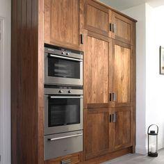 Walnut kitchen cabinets with light grey floor