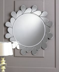 A elegantly stylish mirror, the Tear Drop Mirror gives a breathtaking look with it's designer style. The inside of this mirror is a polished and glamours appearance to your home.