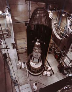 A geodetic laser satellite nestled inside the nose cone of a Delta rocket before its 1976 launch.