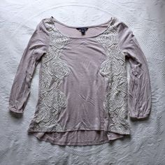 American Eagle White Top White American Eagle top. Lace floral pattern down the sides. 3/4 sleeve length. Lightly used but looks new. American Eagle Outfitters Tops
