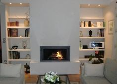 7 cheminees avec insert tendance pour un salon design fireplaces fireplace bookcase and design - Cheminees modernes ...