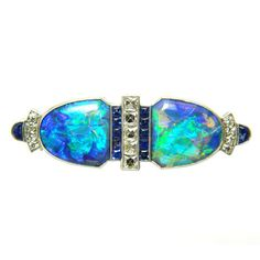 GILLOT & CO Art Deco Diamond, Sapphire & Black Opal Brooch, USA,  1920's.   A Stunning & unique, Art Deco, platinum, diamond, sapphire & black opal brooch.