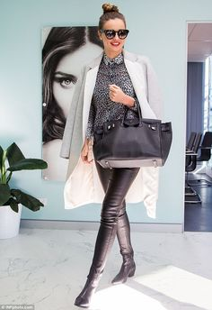 May 15, 2014: The show must go on: Miranda was seen visiting the offices of her KORA Organics skincare b...
