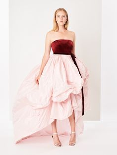 Product Description This enchanting gown is designed with a strapless burgundy velvet bodice and a voluminous high-low skirt made from light pink taffeta. Strapless Dress Formal, Formal Dresses, Wedding Dresses, High Low Skirt, Corset, Bodice, Ready To Wear, Velvet, Gowns