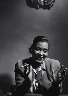Billie Holiday. Of course she smokes. Every great singer seems to smoke. I think that they were feeding me a bunch of CRAP while I was getting my college training!