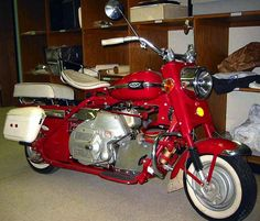 This Cushman Super Silver Eagle scooter, manufactured in 1965, has an air-cooled Husky engine. The Cushman Motor Works of Lincoln manufactured many Eagles for Shrine groups, who were famous for their precision riding maneuvers in parades. Originally owned by an Omaha Tangier Shriner, this scooter bears the Omaha Shrine colors.