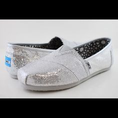 Silver sparkly TOMS Worn a bit because I love these babies:) still in great shape! Offers are welcome everything is better when it's SPARKLY✨ TOMS Shoes Flats & Loafers