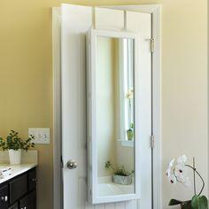 A jewelry organizer and mirror in one? Perfect for small college dorm rooms! The White Wood Over-the-Door Jewelry Armoire Mirror has it all in a clean, white crafted wood finish that will keep your room looking chic.