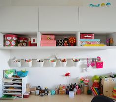 Use a wall rail with BYGEL containers for pens, crayons and pencils | See more of Diana's colourful studio in Italy in live from IKEA FAMILY