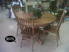 Solid oak with a rich honey finish. Has 5 chairs, an extension leaf, and of course the sturdy pedestal table.