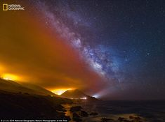 The Soberanes Fire rages south ofPoint Lobos in California, its flaming orange hue providing a stark contrast to the cool colours of the star spangled Milky Way in Beauty Beyond Disaster by Li Liu