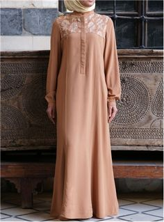 A lengthened and rayon version of our popular 100% cotton Yiannoulla Tunic. This unique design is quite simply the epitome of elegance. The delicate damask embroidery and feminine pleats coupled with any of the striking, bold colors available will be sure to reserve you a place as a modest fashion queen.