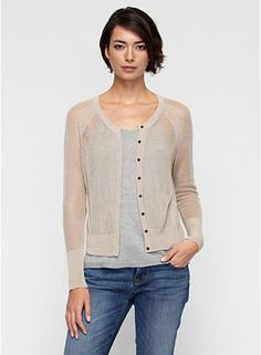 Crew Neck Cardigan in Linear Tencel Lattice Knit  The mesh cardigan with all the right details. Angled jersey bands at the shoulder and sides.      Snap closure, rib trim at cuff and hem.     A lustrous Italian yarn in a linear stitch. Sheer and fluid, by day and by night. Tencel® is made with cellulose from sustainably harvested eucalyptus trees. It is processed in a closed loop, recycling 99.5% of water and solvents.  Details      Dry clean only. Made in USA.     100% Tencel.  (Bought it!)