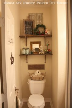 Angela!!!  Reminds me of your bathroom....sweetly decorated....was thinking a painting on the door would be fun...something to look at...a sailboat...for Joseph!!!