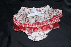 Diaper cover with lots of ruffles on the tushy .