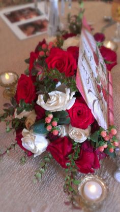 Red and Ivory Florals displayed in a book