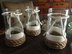 Nautical vases. Rope from Home Depot, vases from $1 store and the magic of a glue gun. Total cost - $4 each.