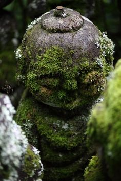 mossy Jizo statue at Otagi Nenbutsu-ji temple, Kyoto, Japan. Jizo Bosatsu (Bodhisattva) is one of the most beloved figures of Japanese Buddhism. He is known in particular as the protector of deceased children.