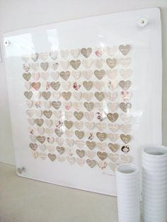 Cute guest book that can be turned into framed art (DIY?): Have people sign kraft paper hearts & then arrange them with vintage themed hearts to create a wall hanging of all the love from your wedding day.