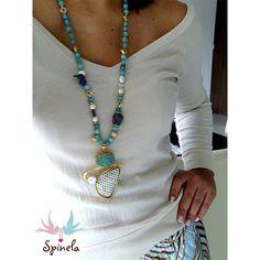 Jade. Dije con incrustación de drusa, perla y aplique en cuero.