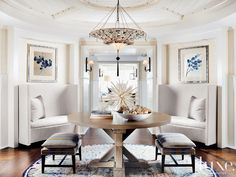 """From Luxe: """"In this entry interior designer Cindy West Ray set a Venetia Studium fixture above a custom ashwood table placed on top of a custom wool-and-silk Orley Shabahang rug."""""""