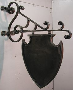 Hey, I found this really awesome Etsy listing at https://www.etsy.com/listing/84727945/iron-scroll-bracket-with-crest-sign-made