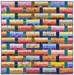 by Laura Nownes | Kaffe Fassett fabrics, nice blend of the prints with the stripes: