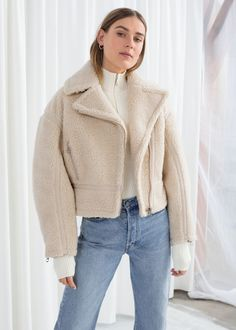 7312637472c Model front image of Stories in beige Faux Fur Cropped Jacket
