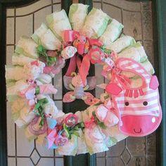 soooo cute and easy!!  Google Image Result for http://1.bp.blogspot.com/_DwCtmQbp0MI/TH7KIUkDy_I/AAAAAAAADq4/mjQIj2J-_Ao/s1600/diaper-baby-wreath-ideas.jpg