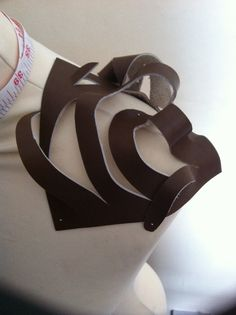 I love playing with creating 3D forms using fabric manipulation (leather)